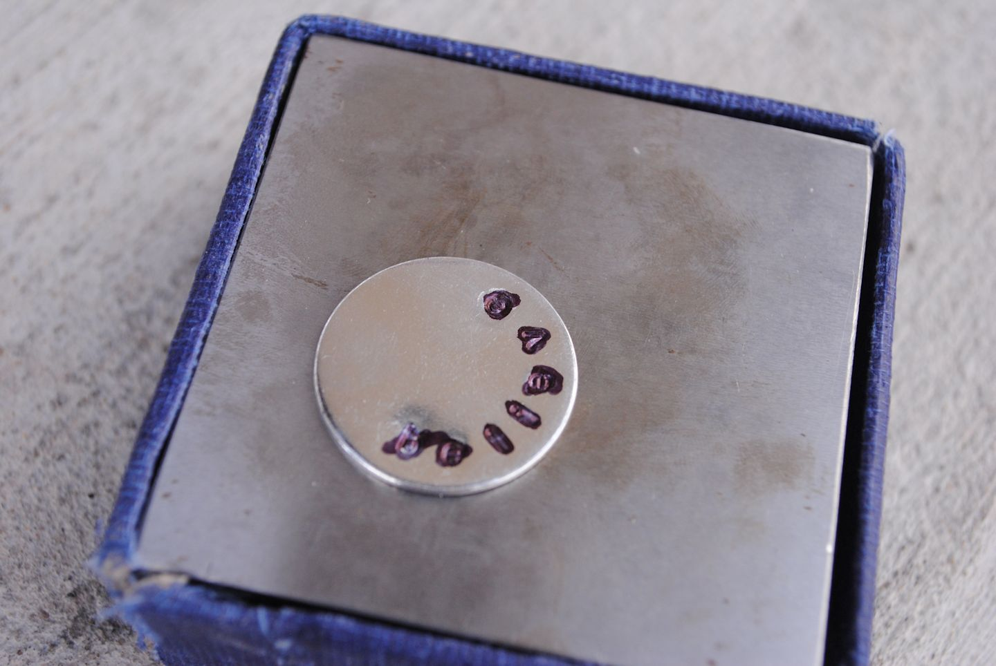 Stamping a mother's necklace