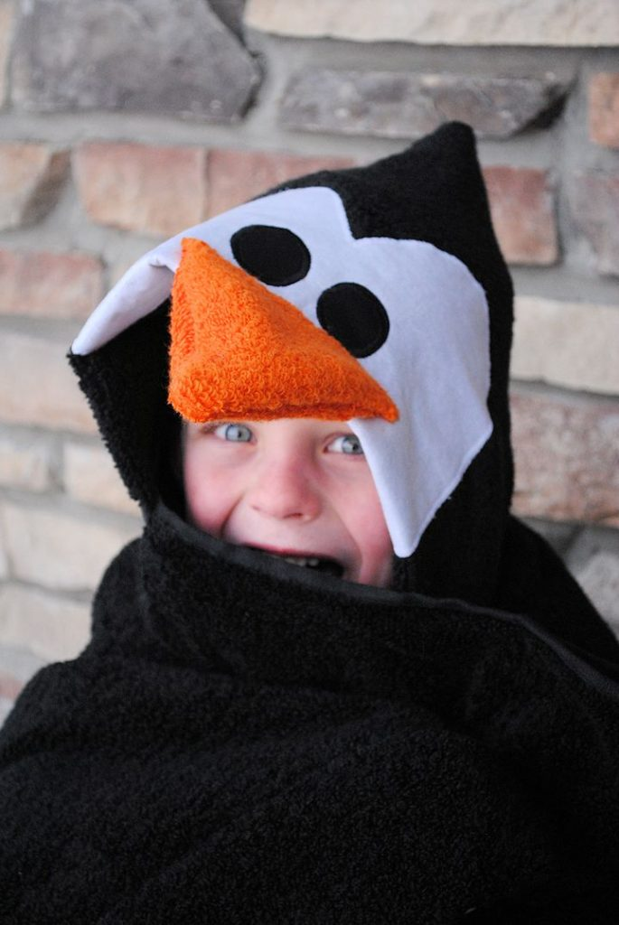 hooded penguin bath towel robe using black and orange towels