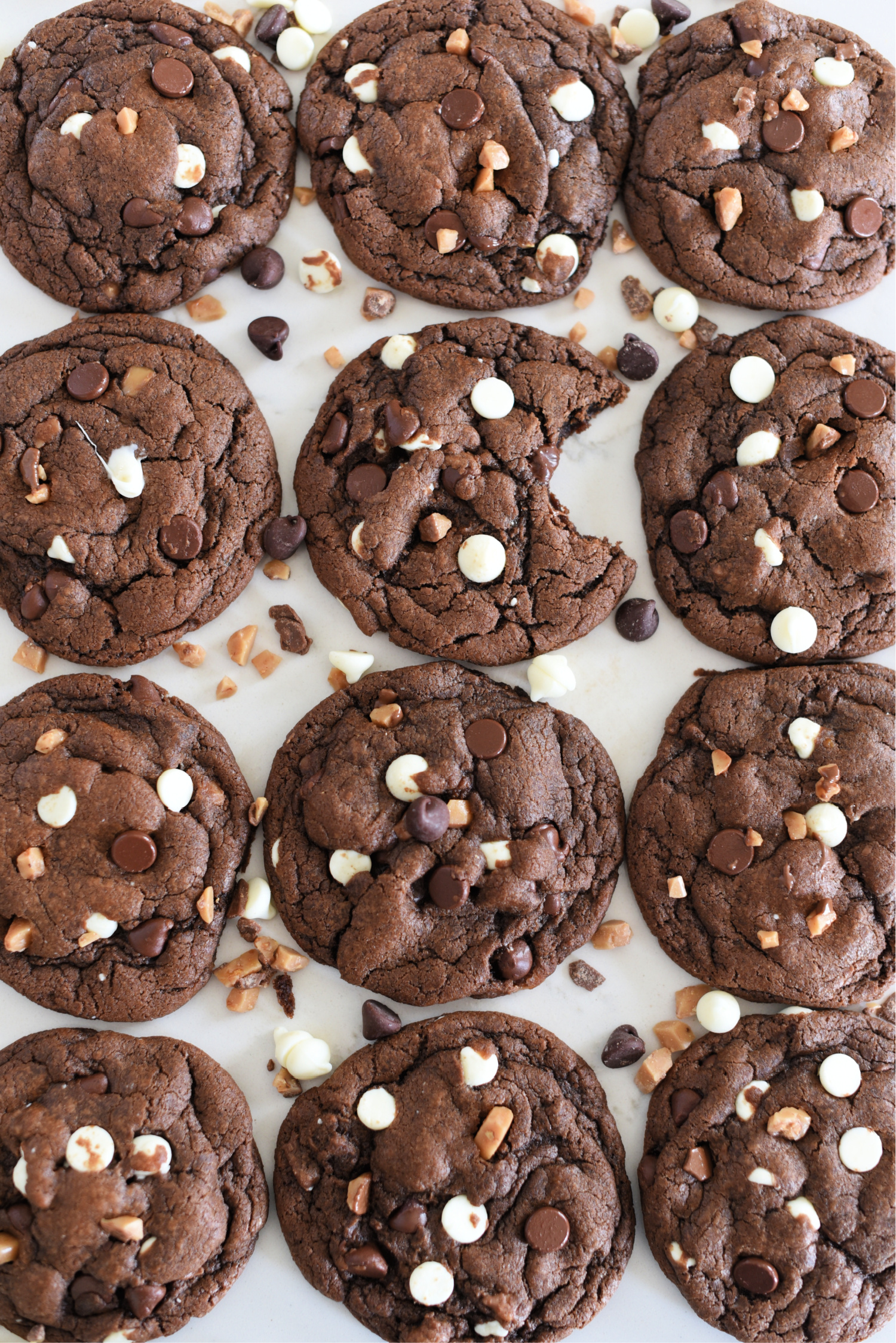 Triple Chocolate & Toffee Cookies: This chocolate chip cookies recipe has a chocolate base, white chips, chocolate chips, and toffee bits and they taste amazing!