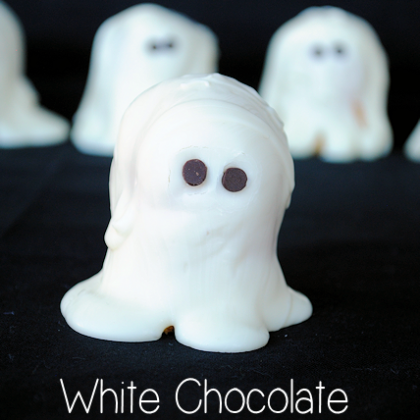 Easy treat for a Halloween party! It's a Twinkie covered in white chocolate...so easy! Crazy Little Projects