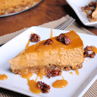 Pumpkin Cheesecake with Candied Pecans and Caramel Sauce