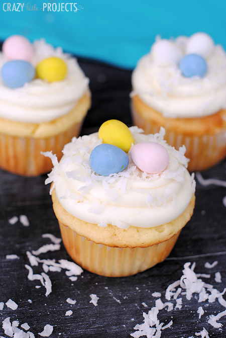 Coconut Cupcakes with Cream Cheese Frosting-Great Easter Dessert Idea! These cupcakes are SUPER easy to make and they taste amazing! Plus they make a great Easter dessert idea! #easter #eastertreats #easterdessert
