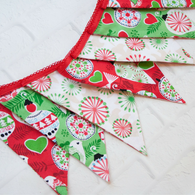 Fabric Banner for Christmas-Make this cute fabric bunting to hang at Christmas! But the best part is that you can reverse it and use it for another holiday too! #sewing #sew #pattern #christmascrafts