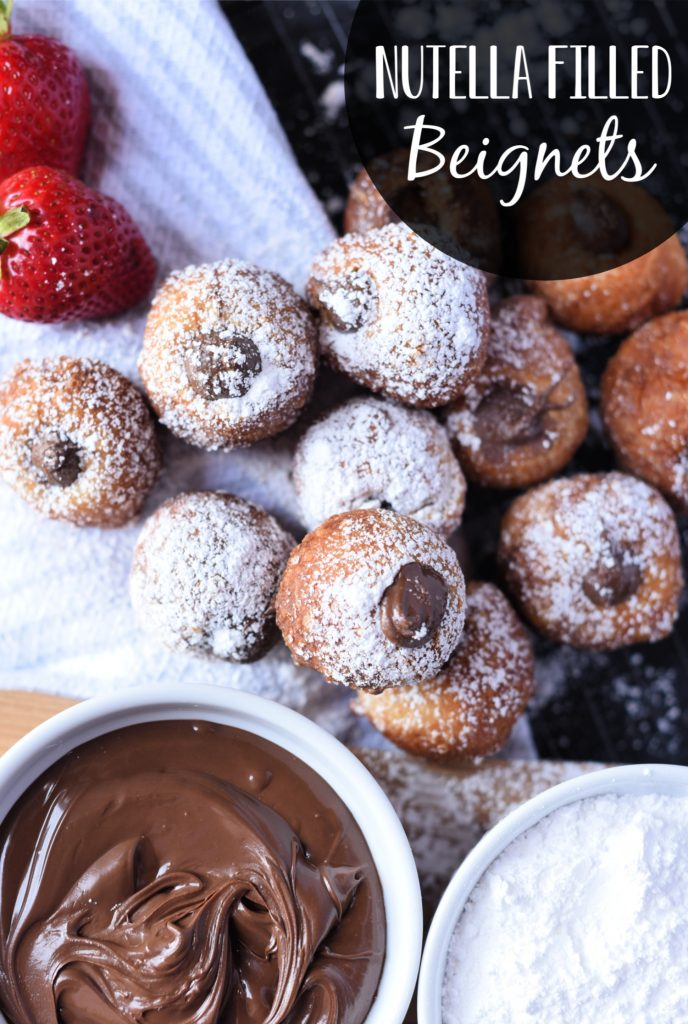 These easy to make Nutella filled French beignets will make you feel like you're in a Parisian cafe. You're going to love how easy this beignet recipe is to make! #beignets #dessert #brunch