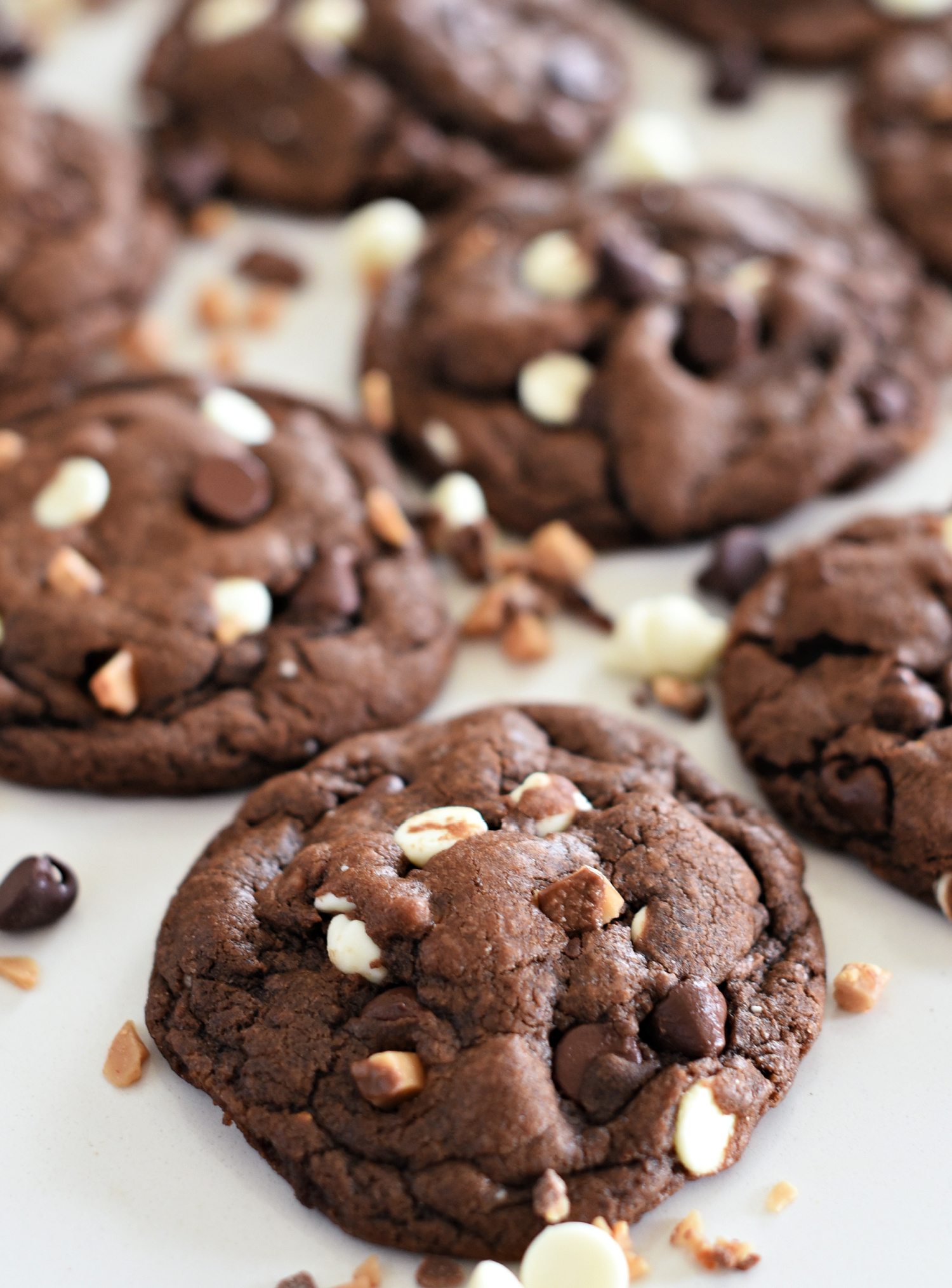 Triple Chocolate Toffee Cookies: White chips, chocolate chips, and toffee bits in a soft and chewy chocolate cookie.